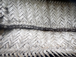 Woven coconut leaf wall covering
